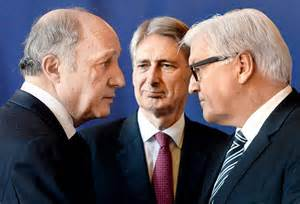 (Left) French Foreign Minister Laurent Fabius speaks with British Foreign Secretary Philip Hammond (centre) and German Foreign Minister Frank-Walter Steinmeier (right)