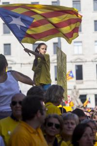 Thousands of Catalan people gather in Catalunya square to hold a rally in support of independence and self-determination referendum in Barcelona on October 19, 2014.