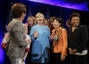 In this Oct. 20, 2014, photo, former Secretary of State Hillary Rodham Clinton, center, gathers with House Minority Leader Nancy Pelosi, left, Rep. Zoe Lofgren, second from left, Rep. Doris Matsui, second from right, and Rep. Barbara Lee, right, for a photo after speaking at a fundraiser for Democratic congressional candidates hosted by Pelosi at the Fairmont Hotel in San Francisco. Bill and Hillary Rodham Clinton are the validators-in-chief for Democrats struggling through a bleak campaign season in states where President Barack Obama is deeply unpopular. (AP Photo/Eric Risberg)