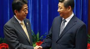 Chinese President Xi Jinping and Japanese Prime Minister Shinzo Abe held formal talks for the first time since the two leaders took office, a breakthrough in ending a two-year row between Asia's biggest economies over history and territory.