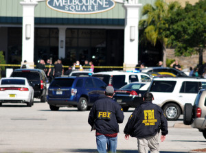 """Law enforcement including the FBI respond to the scene of a shooting at the Melbourne Square Mall on Saturday, Jan 17, 2015 in Melbourne, Fla. Melbourne Police have confirmed that the shooting Saturday morning at the mall has left two people dead and one injured from a gunshot wound. Police say the injured victim is hospitalized in stable condition and cooperating with investigators. After responding to reports around 9:30 a.m. of multiple shots fired inside the mall, police tweeted that the """"shooter is contained."""" (AP Photo/Florida Today, Malcolm Denemark)  NO SALES ORG XMIT: FLROC102"""