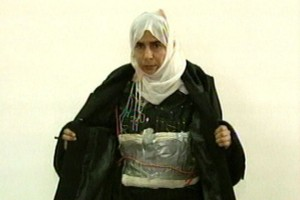In this file image made from television on Nov. 13, 2005, Iraqi Sajida al-Rishawi opens her jacket and shows an explosive belt as she confesses on Jordanian state-run television to her failed bid to set off an explosives belt inside one of the three Amman hotels targeted by al Qaeda.