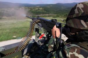 File-Bulgarian trooper fires an M2 Browning .50 cal machine gun at the Novo Selo training range