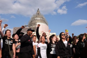 Demonstrators from the March 2 Justice movement gather for March2Justice rally for criminal justice reform legislation to end racial profiling and demilitarize police forces outside the U.S. Capitol April 21, 2015 after a nine day walk from New York City.