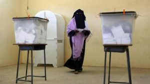 A Sudanese woman prepares to cast her vote at a polling station in Khartoum on April 15, 2015