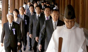 Japanese lawmakers led by a Shinto priest visit the Yasukuni Shrine in Tokyo on Tuesday.
