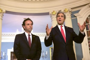 Secretary of State John Kerry (R) and Syrian Opposition Council President Khaled Khoja (L) speak to the press before a their meeting with at the Department of State in Washington, DC on April 30, 2015.