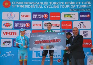 Spanish Pello Bilbao Lopez of Caja Rural Seguros team (C), poses for the media with his award after winning in the 6th stage (Denizli - Selcuk) of the 51st Presidential Cycling Tour of Turkey, on May 1, 2015 in Izmir, Turkey. One hundred and sixty-five participants from over 21 countries will compete in the tour. Competition will be held on April 26 - May 3, 2015 in 8 stages starting from Alanya, proceeding along the Mediterranean and Aegean coasts and will be finished in Istanbul.