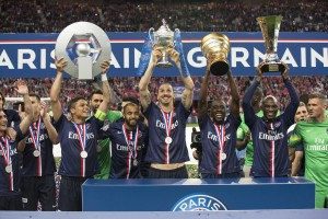 Paris-Saint-Germain's players celebrate after winning the French Cup final football match against Auxerre at the Stade de France stadium in Saint-Denis, north of Paris, on May 30, 2015.