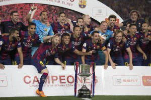 Barcelona's players celebrate the victory after the Spanish King's Cup final football match between FC Barcelona and Athletic Bilbao at the Camp Nou stadium in Barcelona on May 30, 2015.