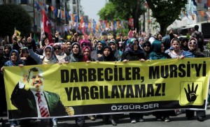 Pro-Islamist demonstrators hold a banner that reads 'Coup leaders can't trial Mursi' during a protest in support former President Mohamed Mursi at the courtyard of Fatih mosque in Istanbul, Turkey, May 17, 2015