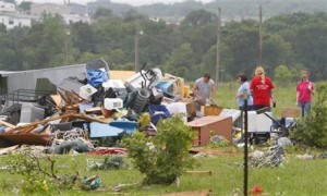 Neighbors and friends help clean up after Thursday night's tornado passed the area on Friday, May 8, 2015 in New Fairview, Texas. Strong storms spawned several tornadoes and dumped heavy rain on North Texas overnight, flooding roads and damaging train tracks in an area where a freight train derailed before dawn on Friday, officials said.
