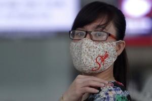A woman wearing a 'stylish' mask waits at Incheon International Airport