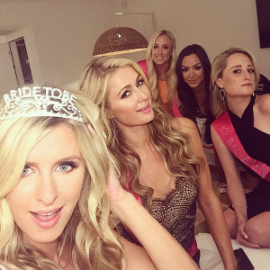 Nicky Hilton (left), sister Paris and friends