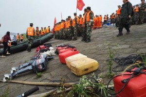 Rescuers gathered near the ship-sinking site Tuesday.