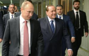 Russian President Vladimir Putin,left, and former Italian Prime Minister Silvio Berlusconi