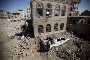 A man stands at the site of Saudi-led air strikes in Yemen's capital Sanaa October 28, 2015.