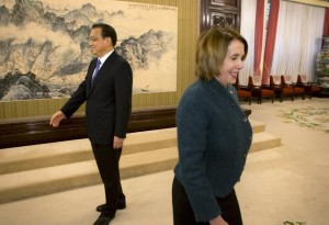 U.S. House Minority Leader Nancy Pelosi (D-CA) arrives for a bilateral meeting as Chinese Premier Li Keqiang (L) waits to greet other guests at the Zhongnanhai leadership compound in Beijing, China November 13, 2015.