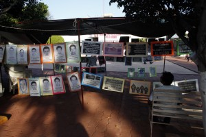 File photo Oct. 1, 2015 A man sits next to a permanent installation memorializing the 43 missing students, outside of the municipal palace in the city of Iguala, Mexico. The disappearance of 43 students at the hands of Iguala police on Sept. 26, 2014 began to unveil the scope of police involvement in Mexico's nearly 26,000 recorded disappearances. Amid national outrage over the students' abduction, hundreds of families came forward to report their missing relatives, many of them also with the complicity of police