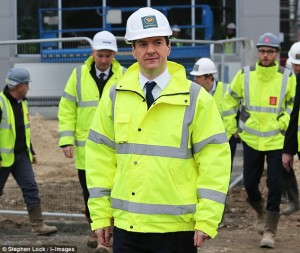 Chancellor George Osborne, pictured on a building site in Tilbury, Essex.
