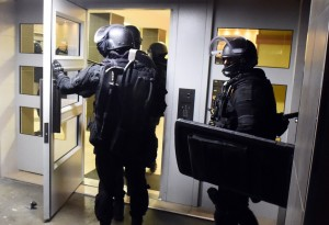 Anti terrorism police officers enter a building during a raid in the Mirail district in Toulouse, southwestern France, Monday, Nov. 16, 2015. France's Prime Minister Manuel Valls says there have been 150 police raids overnight in the country.