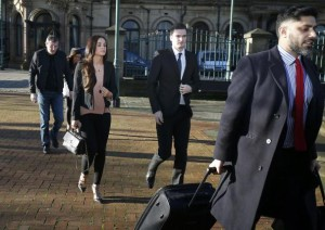 Sunderland soccer player Adam Johnson (C) arrives with his girlfriend Stacey Flounders at Bradford Crown Court in Bradford, Britain February 10, 2016.