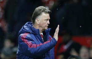Manchester United manager Louis van Gaal waves to fans after the game.