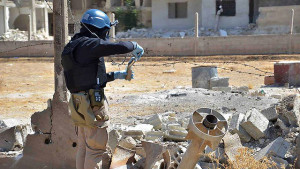 OPCW inspector in Syria collecting samples.