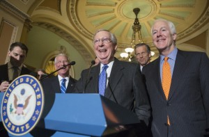 Senate Majority Leader Mitch McConnell of Ky., center, joined by, from second for left are, Sen. Roger Wicker, R-Miss., Sen. John Thune, R-S.D., and Senate Majority Whip John Cornyn of Texas, laughs while meeting with reporters on Capitol Hill in Washington, Tuesday, Feb. 23, 2016.