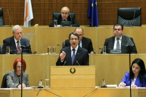 Cyprus' president Nicos Anastasiades, center, speaks to the lawmakers at the Cyprus parliament in divided capital Nicosia, Cyprus, Thursday, Feb. 11, 2016.