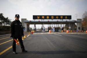A South Korean security guard stands guard on an empty road which leads to the Kaesong Industrial Complex (KIC) at the South's CIQ (Customs, Immigration and Quarantine), just south of the demilitarised zone separating the two Koreas, in Paju, South Korea, February 11, 2016.