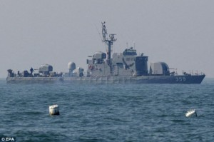 A South Korean navy defense ship on patrol near Yeonpyeong Island .