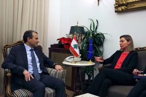 European Union Foreign Policy Chief Federica Mogherini, right, speaks with Lebanese Foreign Minister Gibran Bassil, left, at the Lebanese foreign ministry in Beirut, Lebanon, Monday, March 21, 2016. Mogherini has expressed optimism regarding Syria's peace talks saying there have been positive steps not seen during the Arab country's five-year conflict.
