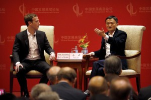 Facebook CEO Mark Zuckerberg, left, listens as Jack Ma, executive chairman of the Alibaba Group, speaks during a panel discussion held as part of the China Development Forum at the Diaoyutai State Guesthouse in Beijing, Saturday, March 19, 2016.