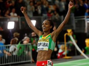 Genzebe Dibaba of Ethiopia celebrates after winning the women's 3000 meters final during the IAAF World Indoor Athletics Championships in Portland, Oregon March 20, 2016.