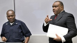 Jean-Pierre Bemba enters the court room of the International Criminal Court in The Hague, Netherlands, Monday, March 21, 2016.