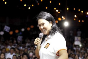 Peruvian presidential candidate Keiko Fujimori of the Fuerza Popular (Popular Force) party talk to supporters during a campaign rally in Villa Maria del Triunfo, on the outskirts of Lima, February 29, 2016.