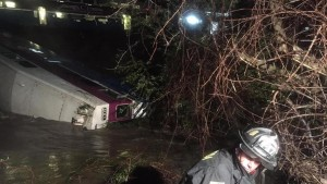 Fire crews work to rescue passengers after an ACE train derailed in the Niles Canyon area of Alameda County near Fremont, Calif., on Monday, March 7, 2016.