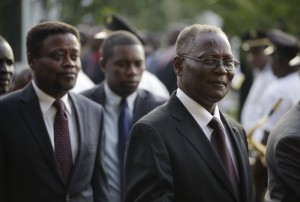 Haiti's provisional president Jocelerme Privert (R) walks followed by appointed prime minister Fritz Jean in the gardens of the National Palace in Port-au-Prince, Haiti, February 26, 2016.
