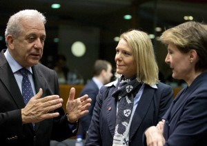 European Commissioner for Migration and Home Affairs Dimitris Avramopoulos, left, speaks with Norway's Migration Minister Sylvi Listhaug, center, and Switzerland's Justice Minister Simonetta Sommaruga, right, during a meeting of EU justice ministers at the EU Council building in Brussels on Thursday, March 10, 2016.