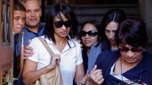 Celeste Nurse,centre left, the mother of a child abducted in 1997, leaves a court with families and friends, in Cape Town, South Africa, Thursday, March. 10, 2016.