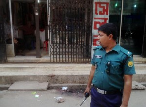 A Bangladeshi policeman stands guard at the site of the murder of a law student, hacked to death by four assailants the night before, in Dhaka on April 7, 2016.