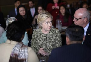 Democratic presidential candidate Hillary Clinton talks to community leaders and politicians at the Jackson Diner in the Queens borough of New York, Monday, April 11, 2016.