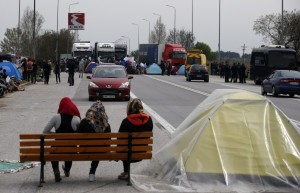 Migrants block the main road to Macedonia near Kilikis, northern Greece, Saturday, April 2, 2016. Greece is pressing ahead with plans to start deporting migrants and refugees back to Turkey next week, despite mounting concern from the United Nations and human rights organizations.