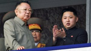 FILE - In this Oct. 10, 2010 file photo Kim Jong Un, right, along with his father and North Korea leader Kim Jong Il, left, attends during a massive military parade marking the 65th anniversary of the ruling Workers' Party in Pyongyang, North Korea. North Korean television announced Monday, Dec. 19, 2011.