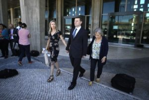 Kate McCann (left) and her husband, Gerry McCann the parents of the missing British girl Madeleine McCann, leave after talking to the media outside a court in Lisbon Tuesday.