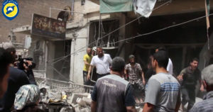 In this image made from video posted online by the Syrian Civil Defense White Helmets, people stand in rubble after airstrikes and shelling hit Aleppo, Syria, Sunday, April 24, 2016.