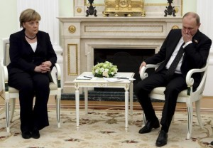 File-Russian President Vladimir Putin (R) meets with German Chancellor Angela Merkel at the Kremlin in Moscow, Russia, in this May 10, 2015.