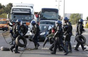French gendarmes remove branches, wood pallettes and tyres after striking workers blocked roads near the oil refinery at Fos-sur-Mer, near Marseille, France, May 24, 2016 with France's hardline CGT and FO unions toughening their stance against labour market reforms.
