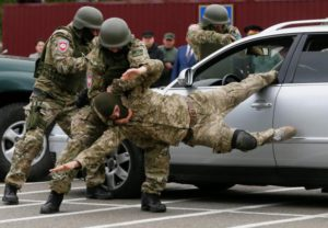 Members of the newly created special police team KORD take part in a demonstration as part of a ceremony to commemorate finishing their training course at a base outside Kiev, Ukraine, May 6, 2016.